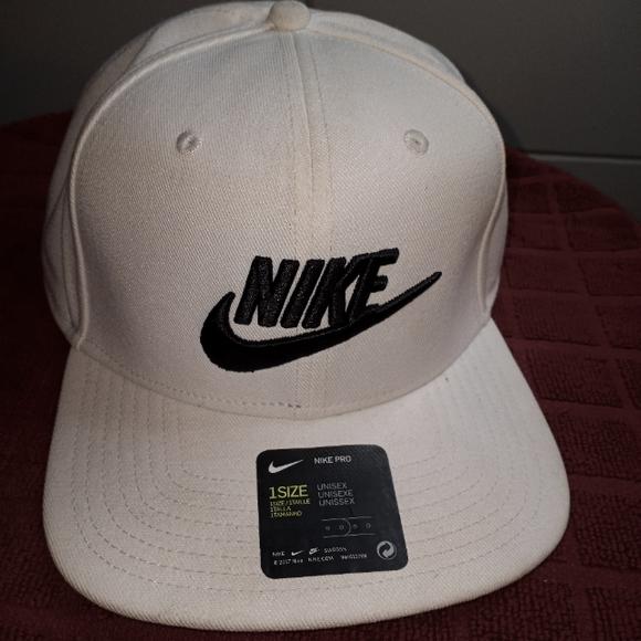 White and blue Nike unisex ADULT hat.